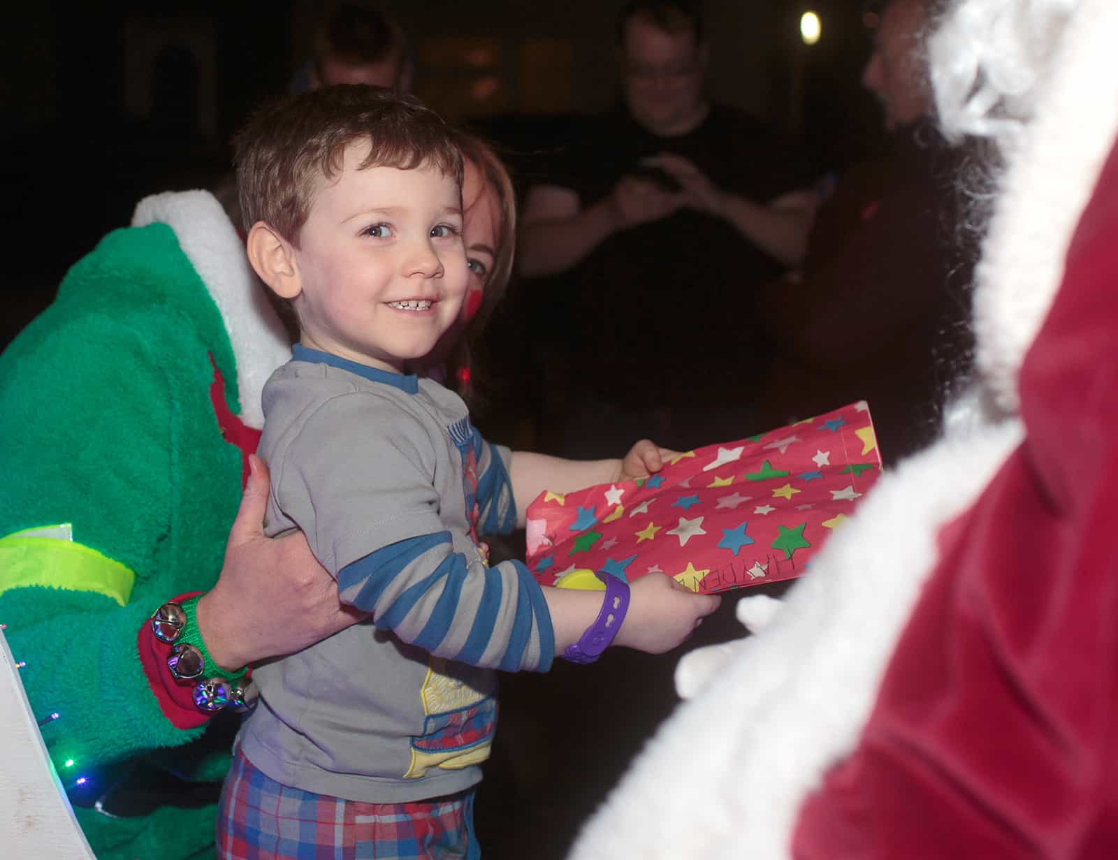 Boy receiving present