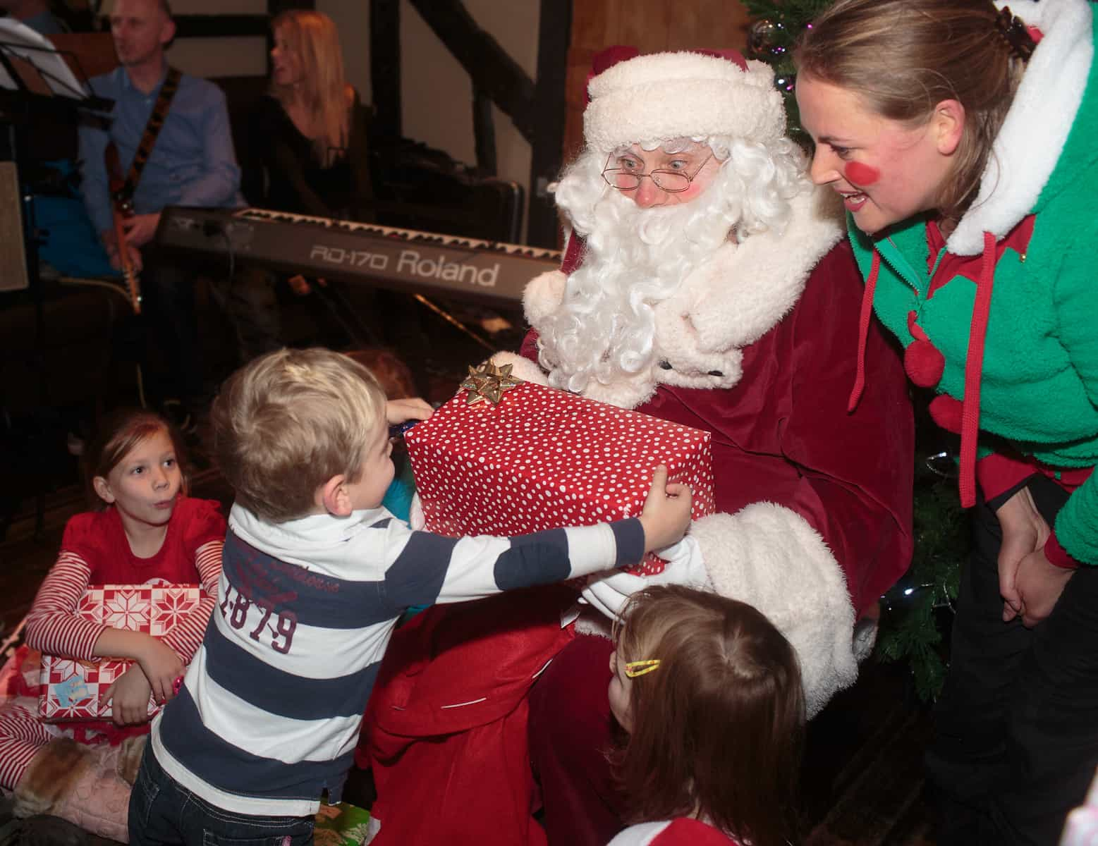 Santa gives presents in The George